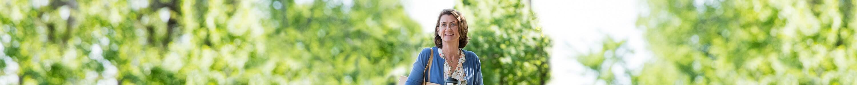 Woman in blue shirt outside